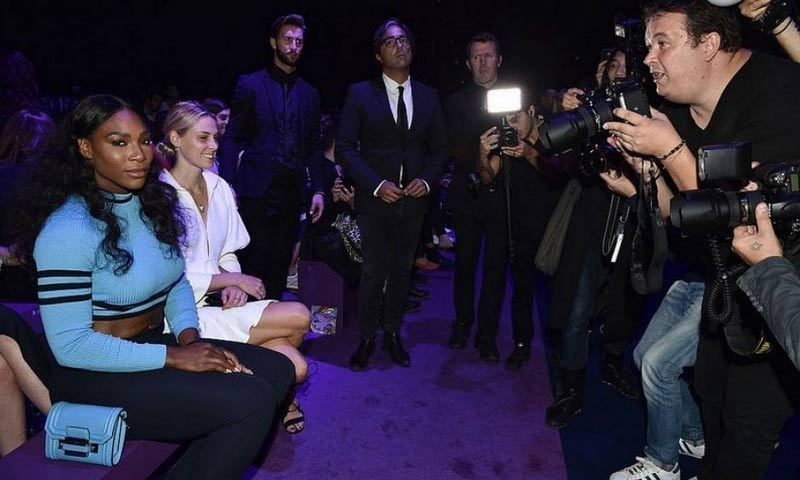 Serena Williams was anything but feeling blue in the front row of the Versace show.
