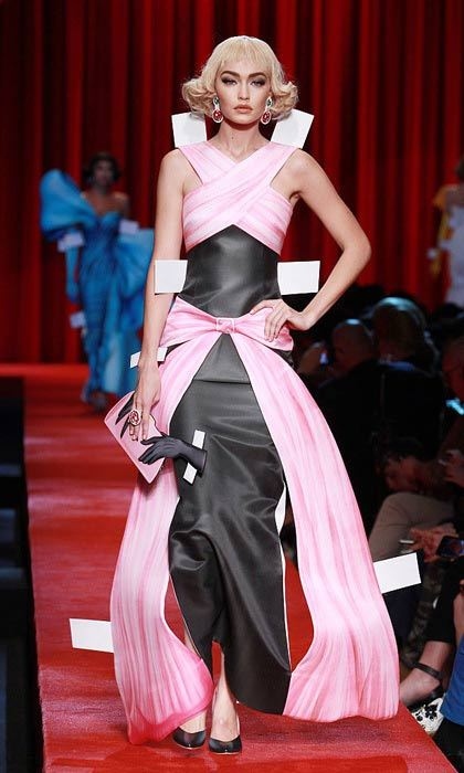 What a doll! Gigi Hadid worked the Moschino runway sporting a short bob as she modeled an elegant pink and black gown.