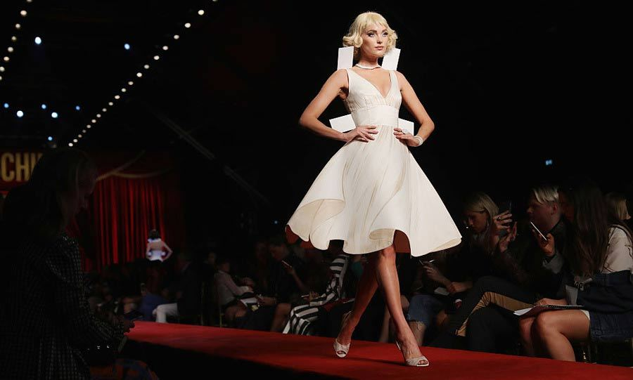 VS Angel Elsa Hosk channeled Marilyn Monroe as she walked the Moschino runway in a white flowing dress.