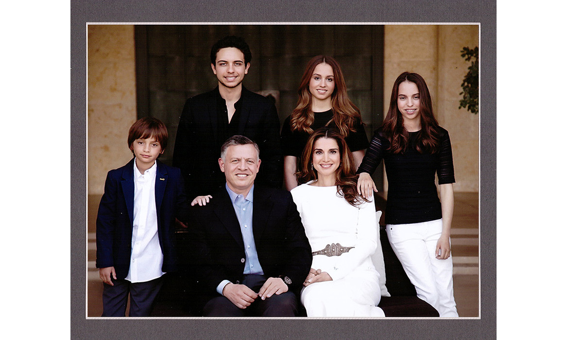 Their 2014 New Year's greeting card showed the handsome family all matching in monochrome looks, with Iman proudly standing behind her mum.