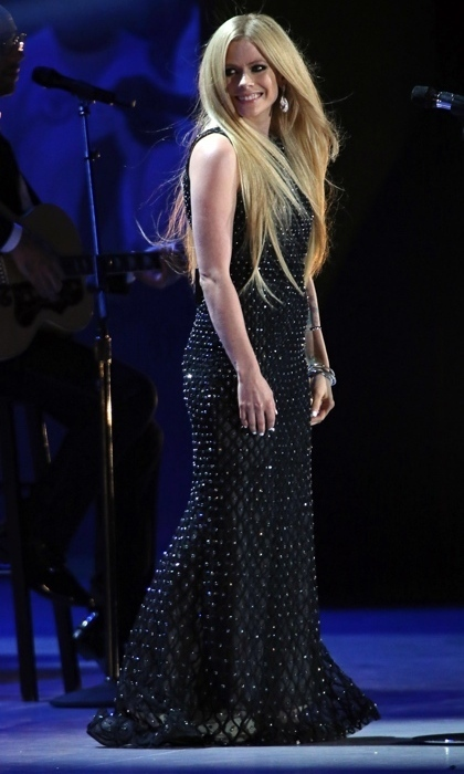 "After a private battle with Lyme Disease, Avril made her return to the stage in the summer of 2015 at the Special Olympics World Games, where she rocked an embellished black gown to debut her inspirational new song ""Fly.""