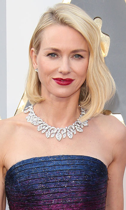 All eyes were on the star as she arrived for the Oscars with her hair in flawless retro-esque waves teamed with bold red lips for an eye-catching finish. 