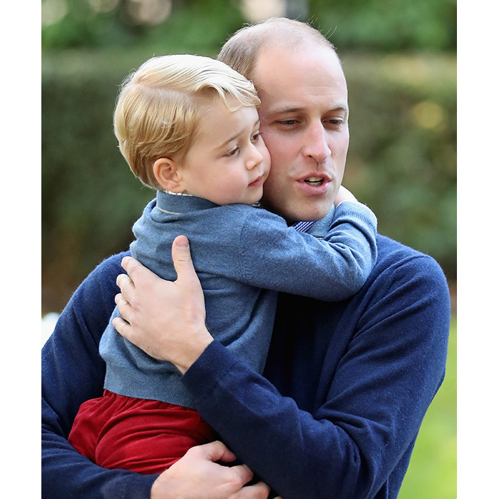 Prince George showed his affection towards his dad, Prince William, by giving him an adorable hug while at a children's party on their royal tour in Canada.