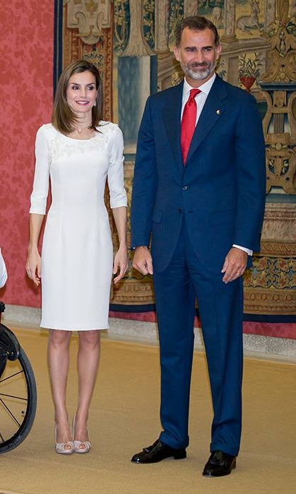 Queen Letizia wore a sophisticated cream knee-length dress to receive Rio 2016 Paralympic medalists at the palace.