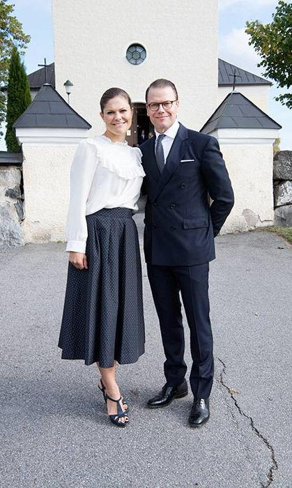 A textured midi skirt and Victorian-style blouse create a demure look for Crown Princess Victoria.