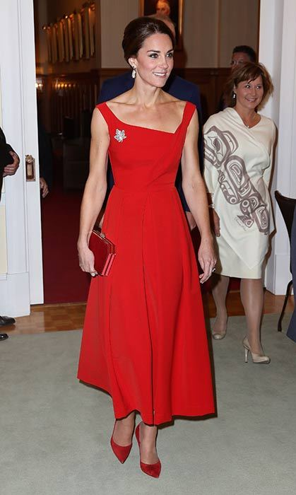 The Duchess of Cambridge looked stunning in a red Preen dress and the Queen's maple leaf brooch for a reception in Canada.