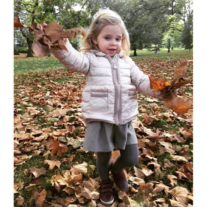 "The adorable princess is ready for fall! The royal tot's mom posted a photo her little girl dressed in her autumn best playing in a pile of leaves. Attached to the photo, Princess Madeleine wrote, ""The fall is here!.""