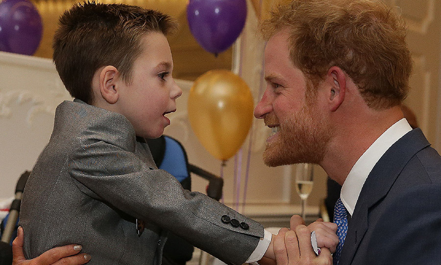 The five-year-old managed to stand up and fling his arms around the royal.