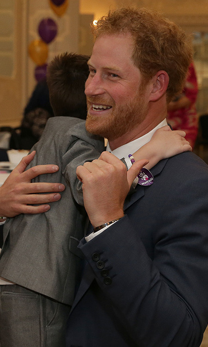 Prince Harry received a heartwarming hug from little Ollie Carroll at the WellChild awards.
