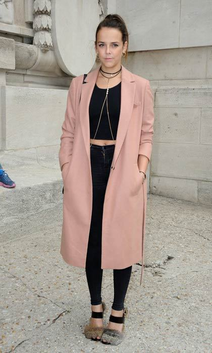 Princess Stéphanie's daughter, Pauline Ducruet, added a pop of color to her black ensemble wearing a pink coat to the Mugler show in Paris.