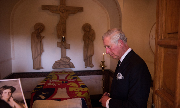 Prince Charles paid a poignant first visit to his grandmother's grave on Friday. 