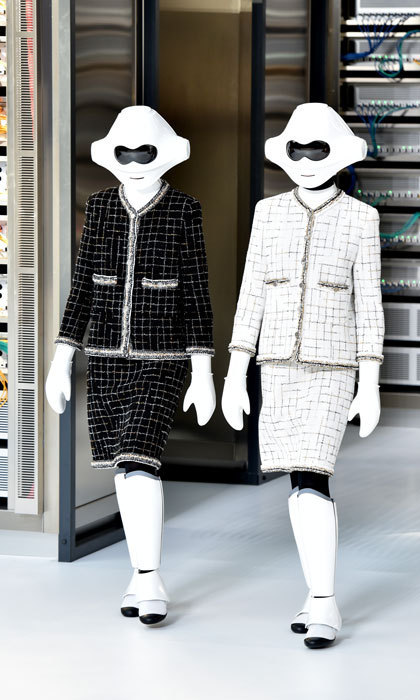 Supermodels weren't the only people, or well things strutting down the Chanel runway. A pair of robots took to the catwalk at label's tech-themed show.