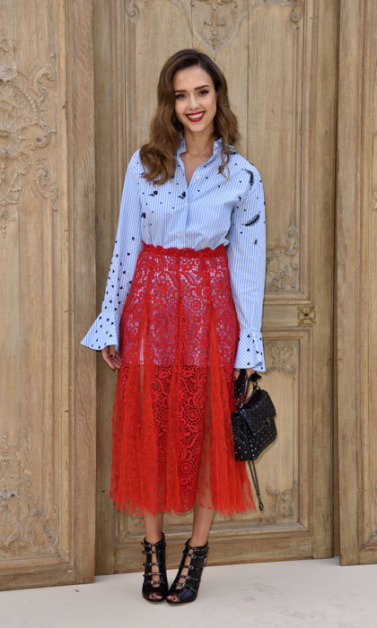 Jessica Alba was one hot mama at the Valentino show! The actress looked stylish at the presentation wearing a pinstriped button down, which featured embellishments and bell sleeves, paired with a lace red midi skirt.