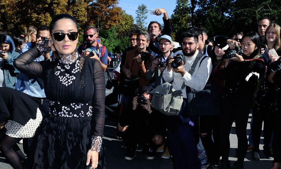 Actress Salma Hayek worked it for the cameras as she made her way into the Giambattista Valli presentation.