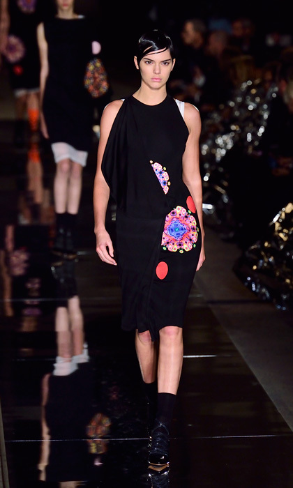 Kendall Jenner made a sleek appearance on the runway of the Givenchy show, modelling a black frock paired with a pixie-like hairstyle.