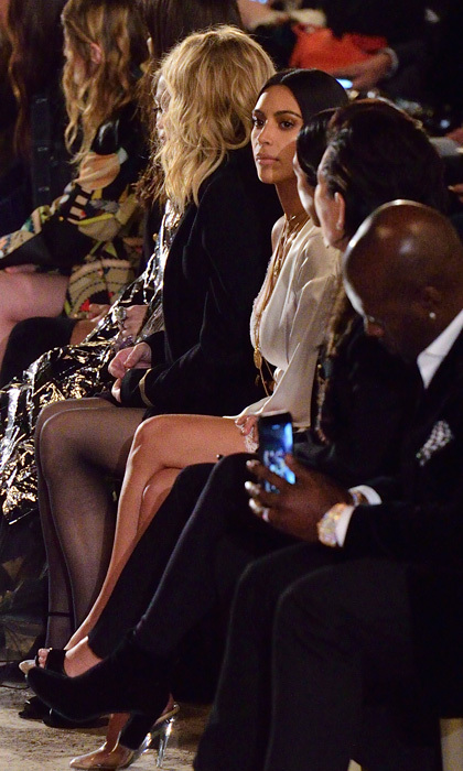 A family affair! Kim Kardashian was joined by her sister Kourtney Kardashian and mom Kris Jenner in the front row of the Givenchy presentation to watch little sister Kendall walk the show.