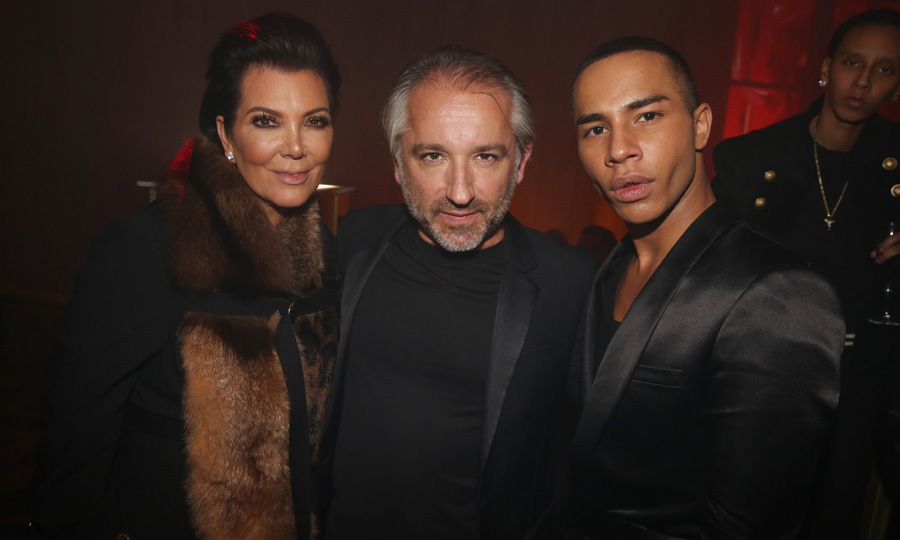 Kris Jenner posed for a photo with Cyril Chapuy and Olivier Rousteing at L'Oreal's Gold Obsession party.