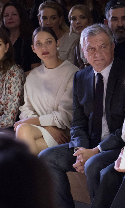 Pregnant Marion Cotillard was a vision in white, sitting front row at the Christian Dior presentation.