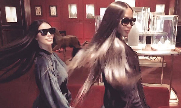 Supermodel Naomi Campbell shared this twinning shot with Kim Kardashian, both flauntin their matching long locks while shopping at Hermes. Giving a shout out to celebrity hair guru Tokyo Stylez, she captioned the pic in part: #letsswingthathair.