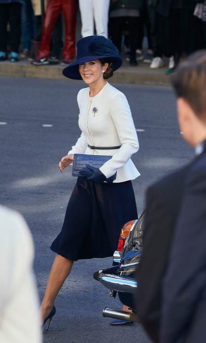 Princess Mary dressed up for the opening of Parliament in a cream peplum jacket and navy accessories.