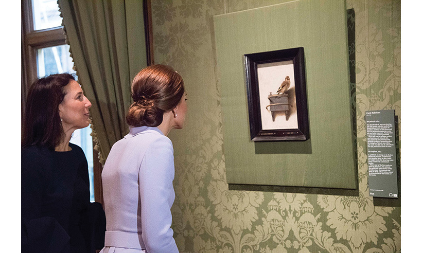 Prince William's wife, who studied art history at university, also stopped to admire The Goldfinch by Carel Fabritius.