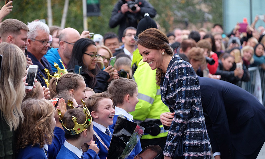 Kate met local schoolchildren outside the iconic Urbis building.