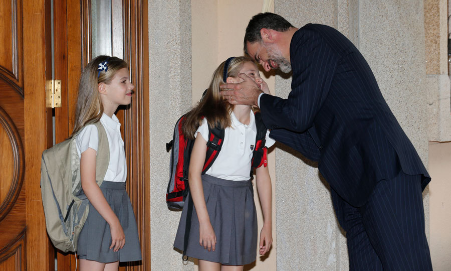 The Spanish princesses shared a tender moment in 2015 with their father King Felipe at their home in Madrid.