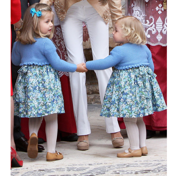 Leonor sweetly held on to her little sister Sofia's hand as they left Easter mass in 2009.