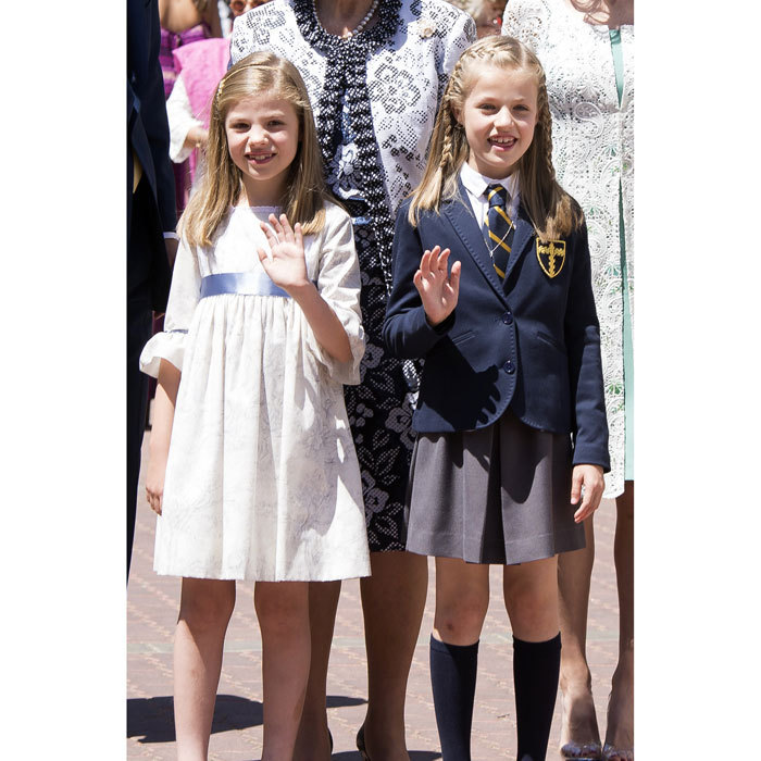 The sisters gave a wave at Princess Leonor's (right) First Communion at the Asuncion de Nuestra Senora Church in Madrid.