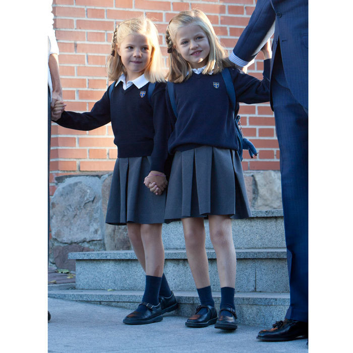 Off to school! Sofia held tightly on to her big sister Leonor's (right) hand as they arrived at the Santa Maria de los Rosales school in 2012. 