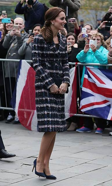 The Duchess of Cambridge wrapped up against the cold in a checked Erdem coat on Friday.