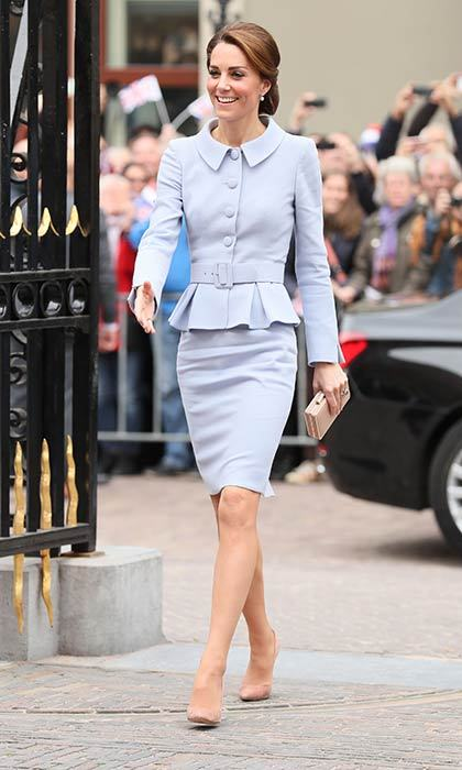 Kate wore a sophisticated Catherine Walker suit for her first solo overseas engagement.