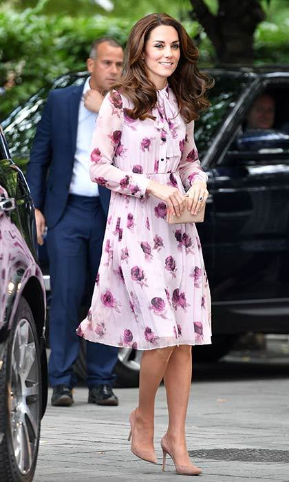 The Duchess was pretty in a pink rose print Kate Spade dress as she marked World Mental Health day in London on Monday.