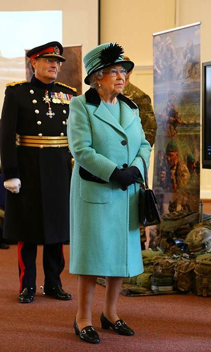 The Queen wore a vibrant blue coat and matching hat for her visit to the Corps of Royal Engineers in Chatham, Kent.