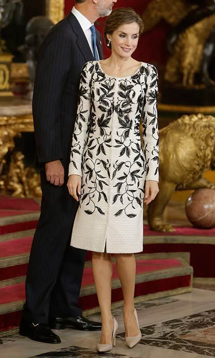 Queen Letizia attended a reception to mark Spain's National Day while wearing an intricately patterned dress and cream court shoes.