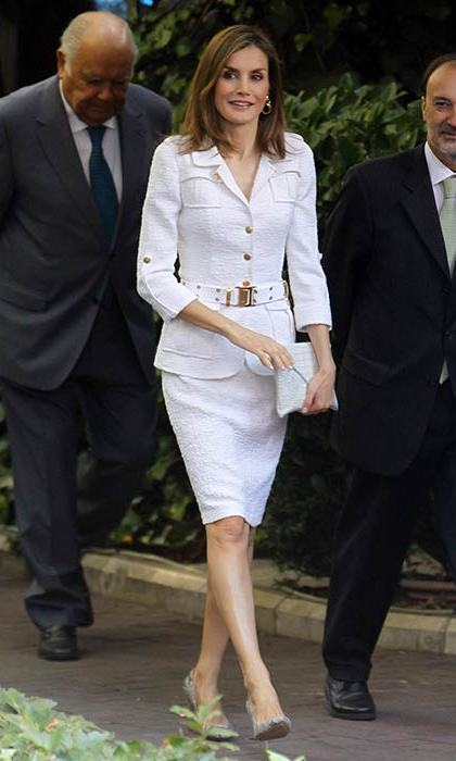The Spanish Queen donned a white skirt suit to attend a seminar in Madrid on Monday.