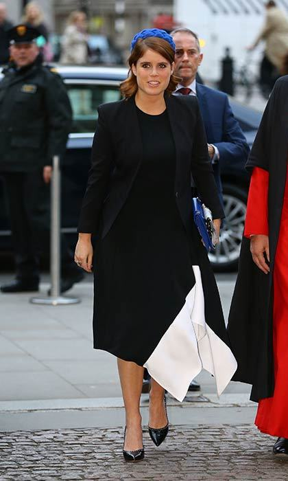 Princess Eugenie added a pop of colour to her monochrome ensemble with a cobalt hat and clutch bag.