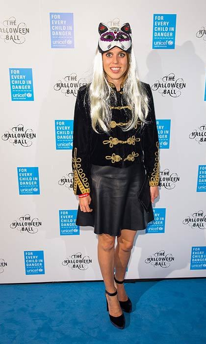Princess Beatrice got into the Halloween spirit at UNICEF's annual Halloween ball by adding a blonde wig and mask to her black leather skirt and military style jacket.