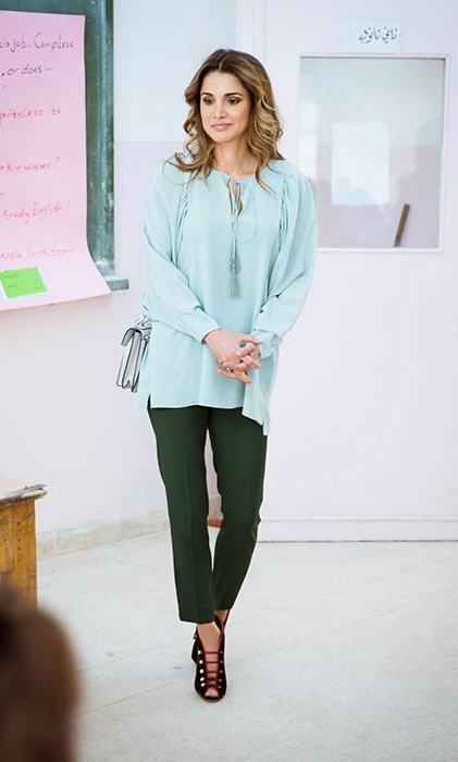 Queen Rania worked colour blocking in a turquoise top and green tailored trousers.
