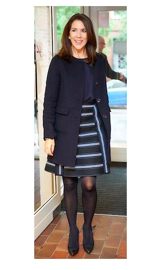 Princess Mary pared back her A-Line striped skirt with a navy blouse and coat for an outing in Copenhagen.