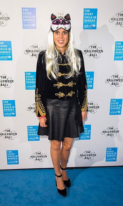 Princess Beatrice worked a feline-inspired costume on the blue carpet at UNICEF's Halloween Ball in London. 