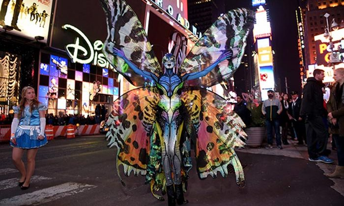 Heidi Klum morphs into a butterfly for Halloween 2014.