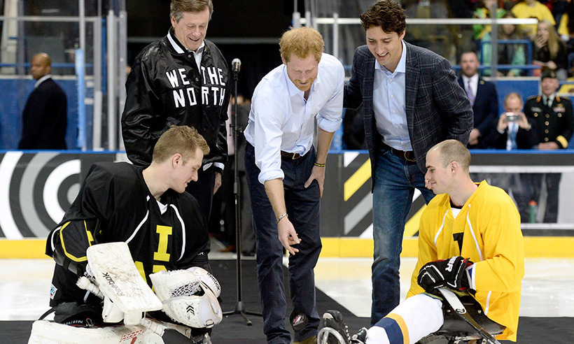 "Justin ""faced off"" against Prince Harry in a sledge hockey match at Ryerson University's Mattamy Athletic Centre while the royal visited Toronto in May to launch the countdown for the 2017 Invictus Games. <br>Photo: © CP/Nathan Denette"