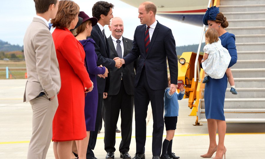 Prince William and Kate and their two children, Prince George and Princess Charlotte, were given a ceremonial welcome to Canada as they touched down in the city of Victoria on Sept. 24. Justin and Sophie were among the first people to greet the royals as they stepped off the plane. <br>Photo: © PA