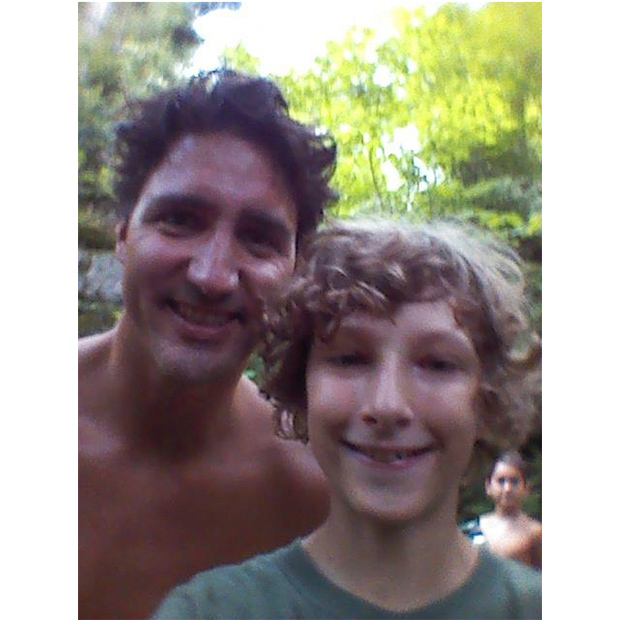 Peterborough, Ont. native Jim Godby and his family set out on a hike in Quebec's Gatineau Park, and encountered a shirtless Justin Trudeau enjoying the outdoors with his family in August. The father of two was on a camping trip in the park when he stumbled upon the Canadian prime minister leading wife Sophie and their three children out of the region's Lusk Cave. The gracious prime minister posed for a selfie with Jim's son Alexander, which quickly went viral. <br>Photo: © Jim Godby via PTBO Canada