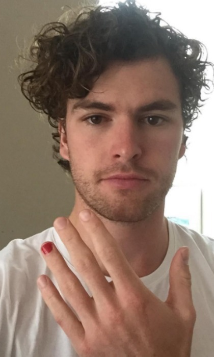 Singer Vance Joy painted his nail red for the #polishedman challenge. 