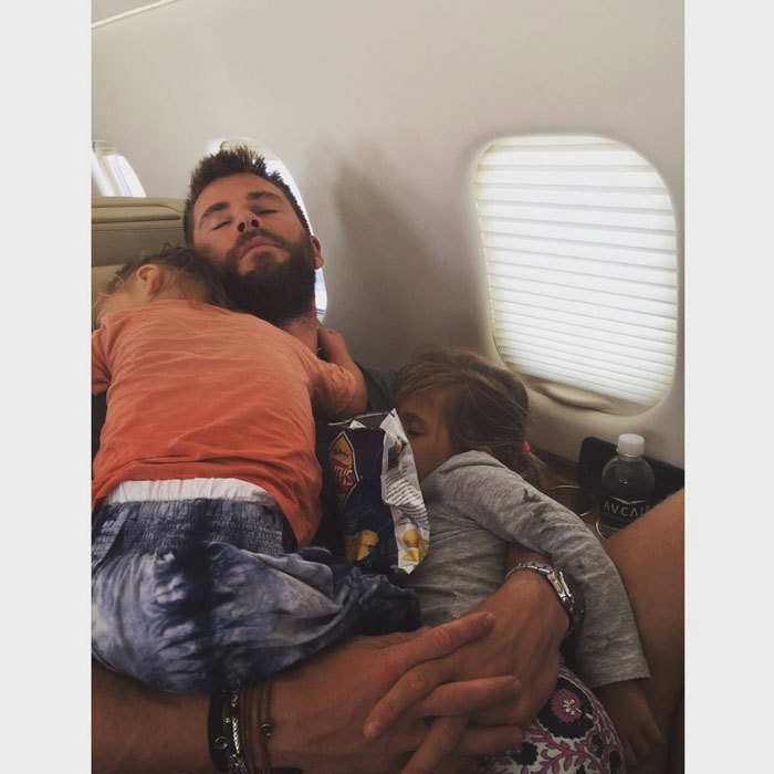 Kanye isn't the only Hollywood dad that likes to nap with his kids. Chris Hemsworth passed out on a flight cradling two of his three children.