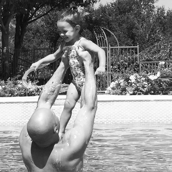 "Summer fun! Vin Diesel gave his daughter Pauline a lift in the pool. The <em>Fast & Furious</em> star simply captioned the photo, ""Happy...""