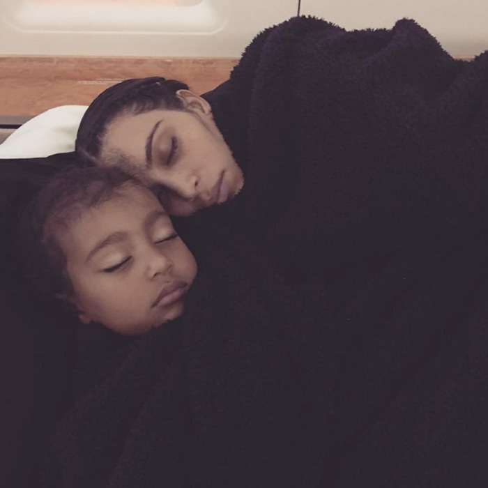 Sleeping beauties! Kim Kardashian rested beside her daughter North West.
