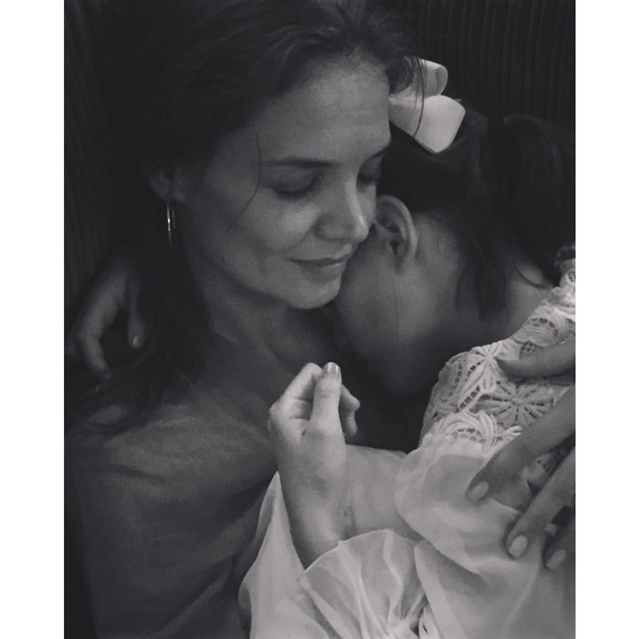 "Katie Holmes is grateful for her little girl. The actress cuddled with her ""angel,"" daughter Suri, after a surprise party for her own mother, Kathleen. The <em>Dawson's Creek</em> star captioned the tender photo, ""#blessed #goodnight #gratitude.""